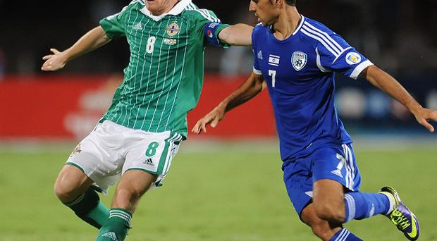 Steven Davis, left, was happy to see Northern Ireland finish on a high