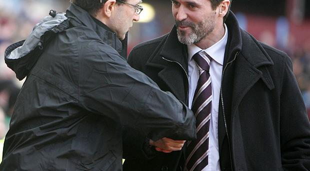 Martin O'Neill, left, and Roy Keane, right, signed two-year contracts with the FAI on Tuesday
