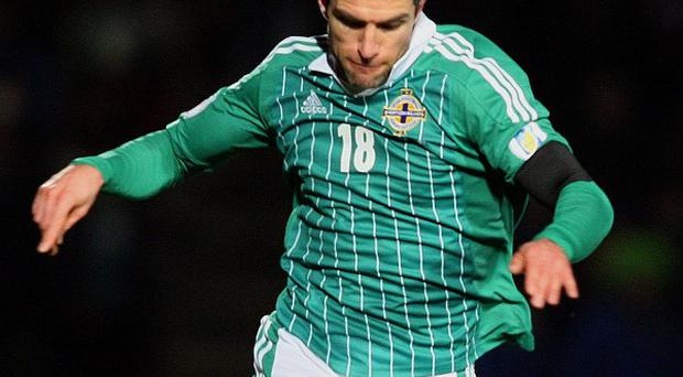 Aaron Hughes has no intention of ending his international career