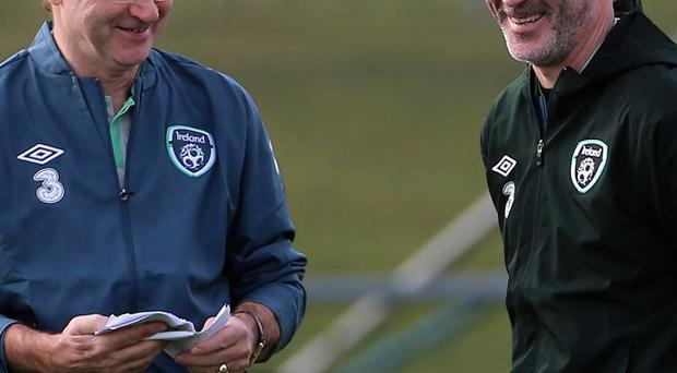 Martin O'Neill, left, has told his squad to go out take the game to Serbia