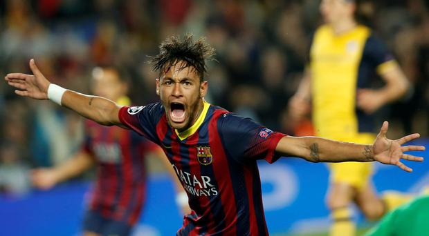 Barcelona's Neymar celebrates after scoring his side's first goal during a first leg quarterfinal Champions League soccer match between Barcelona and Atletico Madrid at the Camp Nou stadium in Barcelona, Spain, Tuesday April 1, 2014. (AP Photo/Emilio Morenatti)