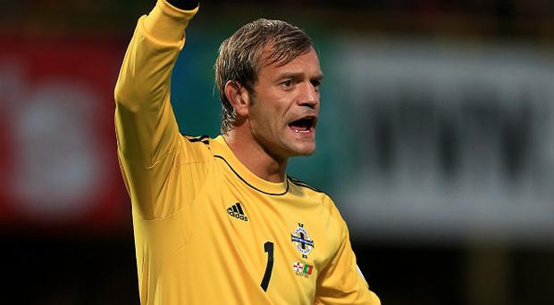 Northern Ireland goalkeeper Roy Carroll is eyeing a return to England