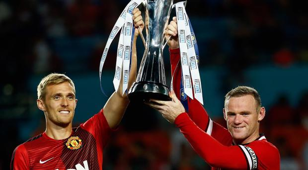 Prize guys: Darren Fletcher and Wayne Rooney celebrate clinching the International Champions Cup in Miami