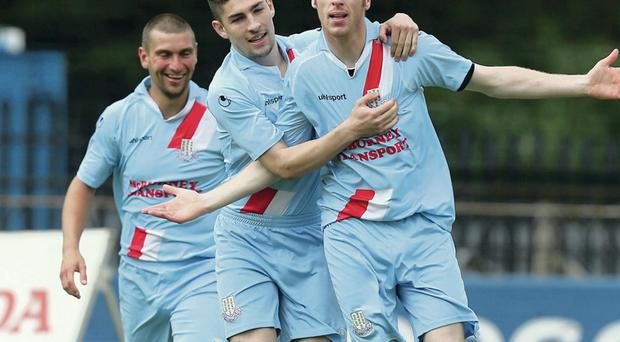 VICTORY MARCH: Matthew Tipton and Michael Ruddy set off in pursuit of Darren Boyce after his decisive Showgrounds strike