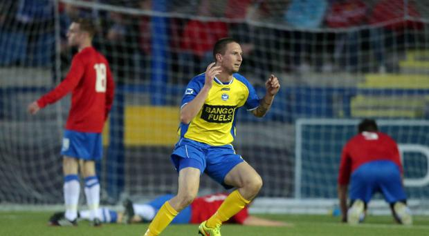Pick that out: Bangor's Mark Cooling enjoys the moment after scoring the equaliser against Ards at Clandeboye last night
