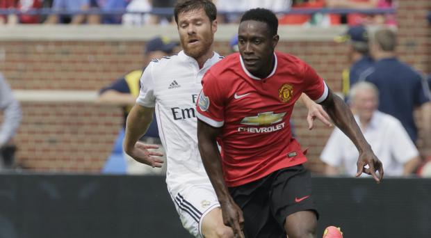 Catch me if you can: Danny Welbeck shows Real Madrid's Xabi Alonso a clean pair of heels during the recent friendly in America
