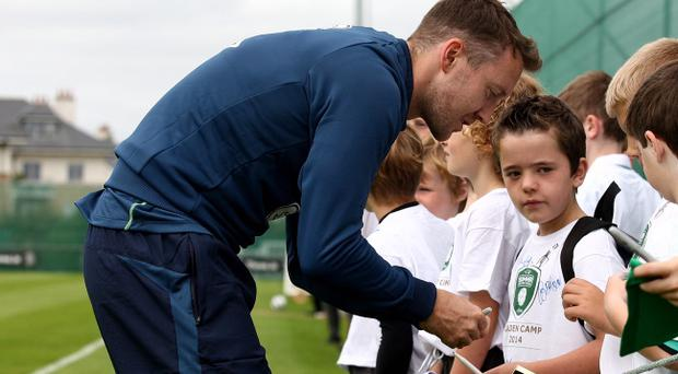 Sign of the times: Aiden McGeady signs autographs for young Republic of Ireland fans at Malahide yesterday