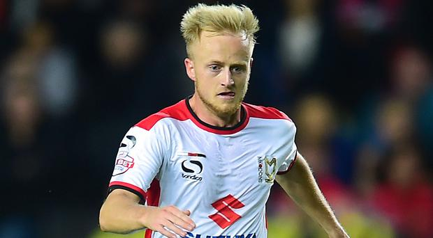MK Dons midfielder Ben Reeves, pictured, and Hull defender Alex Bruce have pulled out of the Northern Ireland squad to face Hungary on Sunday