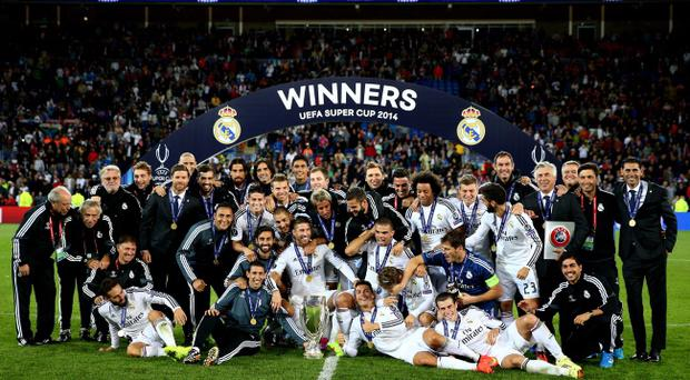 Star billing: Real Madrid celebrate winning this season's Super Cup. The IFA hopes Windsor Park can host the match when the redevelopment is completed