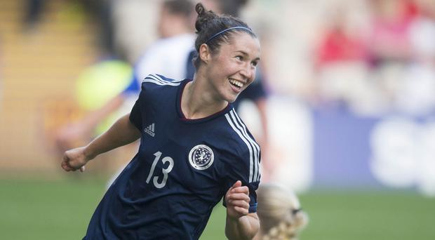 Jane Ross celebrates after scoring her third goal against the Faroe Islands