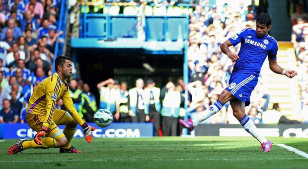 Magic number: Diego Costa keeps cool to score his and Chelsea's third goal against Swansea, taking his tally to seven league goals in four games