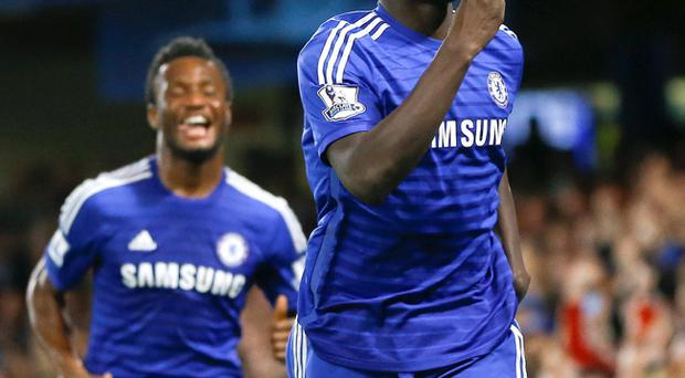 Celebration: Chelsea's Kurt Zouma is among the goals on his debut at Stamford Bridge