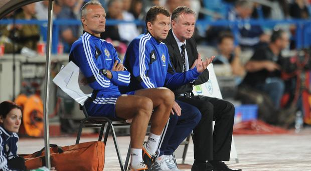 Northern Ireland manager Michael O'Neill (right) with new Stoke assistant coach Billy McKinlay (centre)