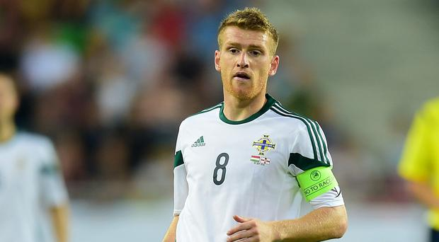 Northern Ireland captain Steven Davis has been ruled out of his side's trip to Romania