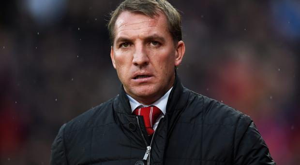 Under a cloud: Brendan Rodgers is feeling the pressure at Liverpool