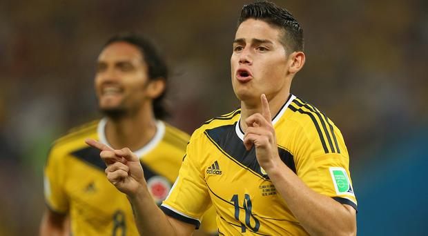 Steph Roche will compete against James Rodriguez, pictured, and Robin van Persie for goal of the year