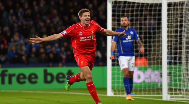Smiles better: Steven Gerrard enjoys the moment after scoring for Liverpool against Leicester City last night