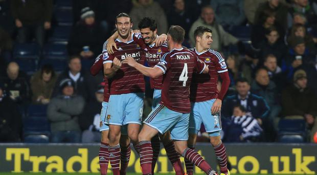 Game winner: James Tomkins celebrates with Andy Carroll and Kevin Nolan after scoring West Ham's second goal