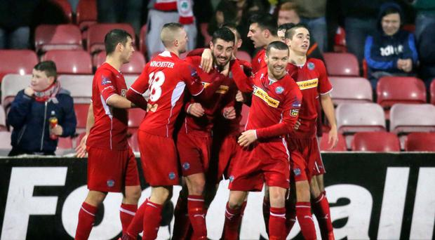 That man again: Cliftonville stars mob Joe Gormley after the hotshot scored the first goal of his double at Solitude