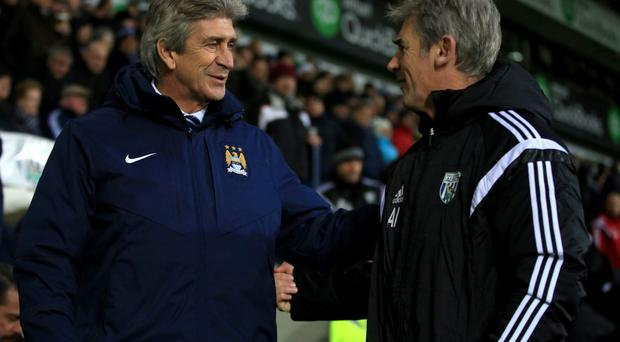 No contest: Irvine (right) with Manuel Pellegrini after the game