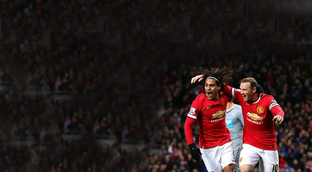 Happy days: Wayne Rooney is congratulated by Radamel Falcao after the Colombian set up the England star's opening goal