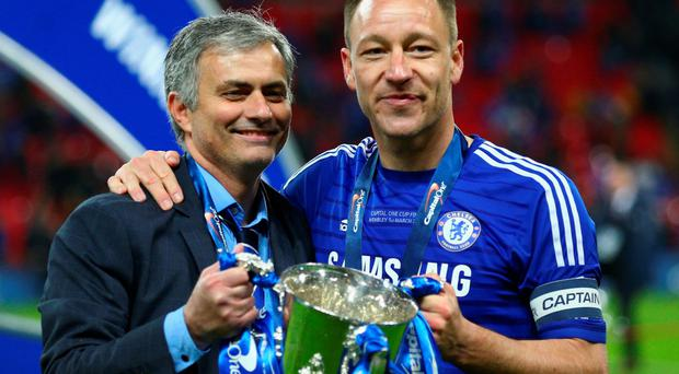 Silver lining: Chelsea manager Jose Mourinho and his skipper John Terry proudly hold the League Cup