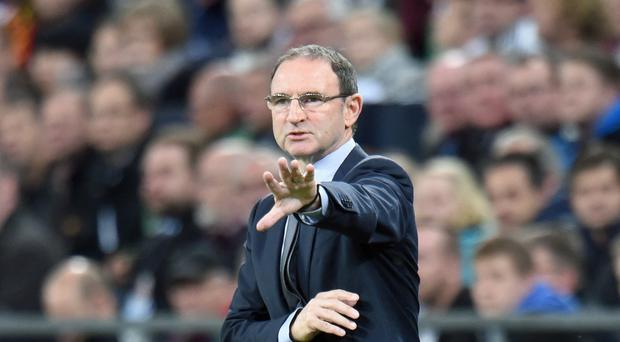 Republic of Ireland manager Martin O'Neill, pictured, has challenged his players to seize the moment and drag themselves back into the race for Euro 2016 qualification against Poland