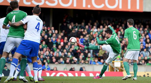 Kyle Lafferty scores the first of his two strikes