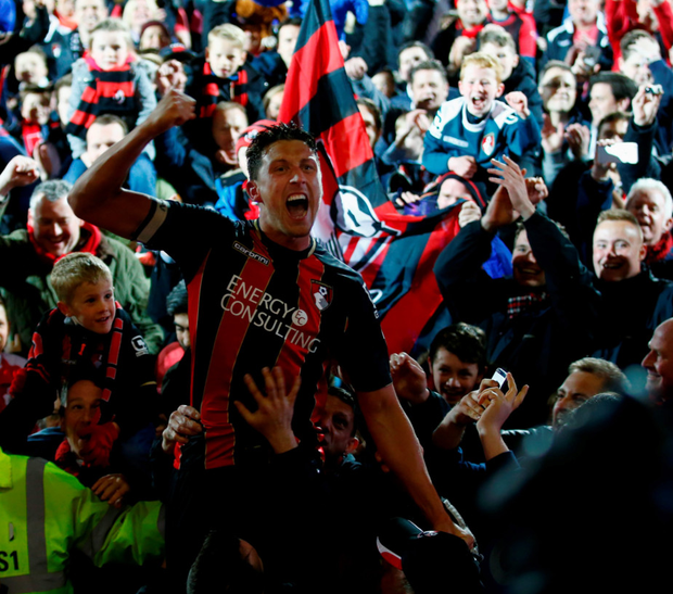 Joy unlimited: Captain Tommy Elphick celebrates with the fans