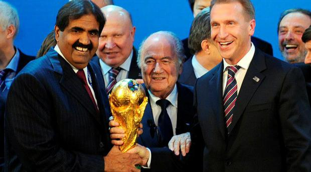 Fifa furore: The Emir of the State of Qatar Sheikh Hamad bin Khalifa Al-Thani (l), Fifa President Sepp Blatter (c) and Russia's Deputy Prime Minister Igor Shuvalov back in 2010 when the country's successful World Cup bids were announced