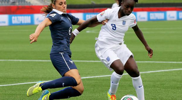 In control: Eniola Aluko (right) in action against France