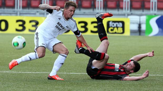 Crusaders captain Colin Coates, right, hopes to avoid slipping up in their Champions League qualifier