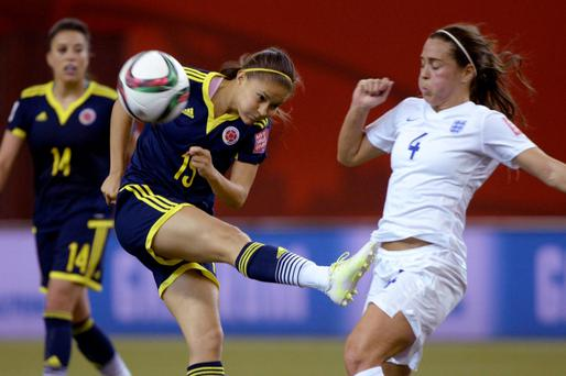 Key role: Fara Williams (right) has started every game of England's World Cup campaign