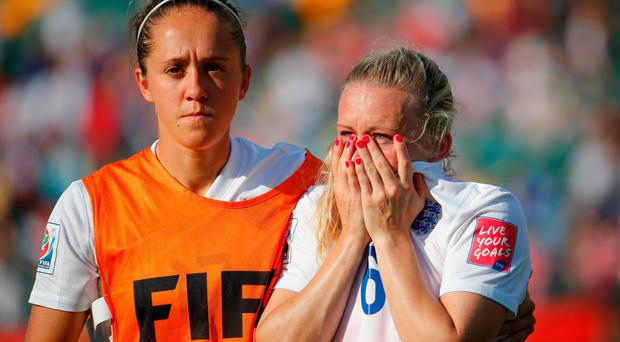 World of woe: Laura Bassett of England is comforted by Jo Potter after their World Cup exit
