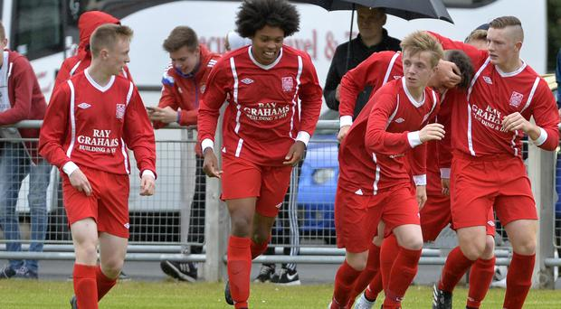 Co Down's Alex McIlmail celebrates after putting his side into a 1-0 lead