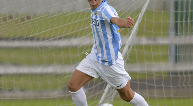 Thistle do nicely: Malaga's Brian Racero Nieto celebrates after giving his side the lead in their Dale Farm Milk Cup Premier Section clash with Partick Thistle