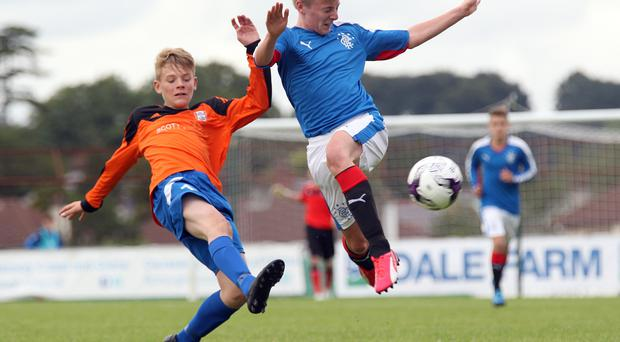 Up close: Matthew Sheils of Rangers and Fermanagh's Dean Corrigan battle it out at Ballymena Showgrounds