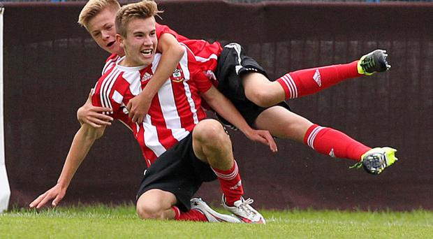 Here we go: Southampton's Jake Volkins celebrates with team-mate Joe Tomlinson after scoring against Liverpool