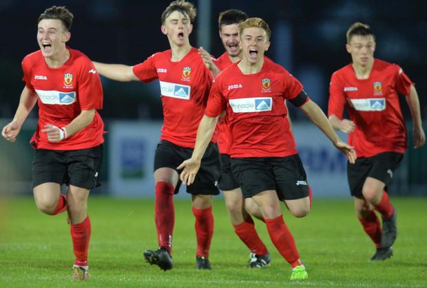 Night to remember: Co. Antrim celebrate Milk Cup success after beating Club America on penalties at Ballymena Showgrounds