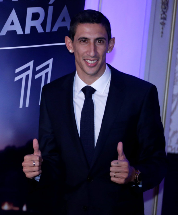 Thumbs up: Angel di Maria is delighted as he is officially unveiled as a Paris St Germain player after leaving Man United