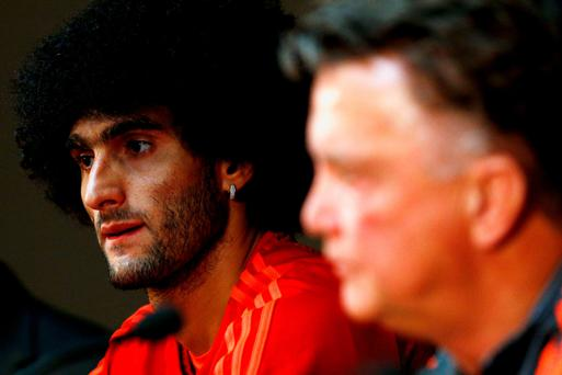 At the double: Marouane Fellaini and Louis van Gaal look ahead to the Champions League play-off second leg against Brugge