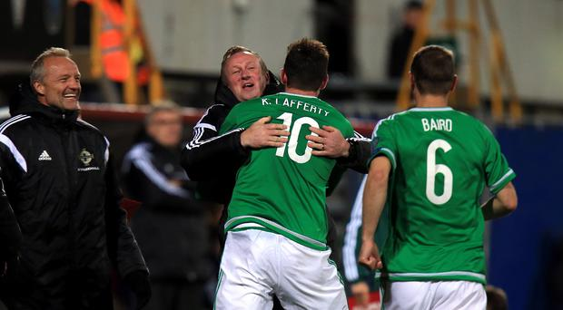 Michael O'Neill is mobbed by Kyle Lafferty following the striker's goal in Torshavn