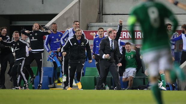 Stephen Robinson, far left, has had much more to celebrate with Northern Ireland than Motherwell this year