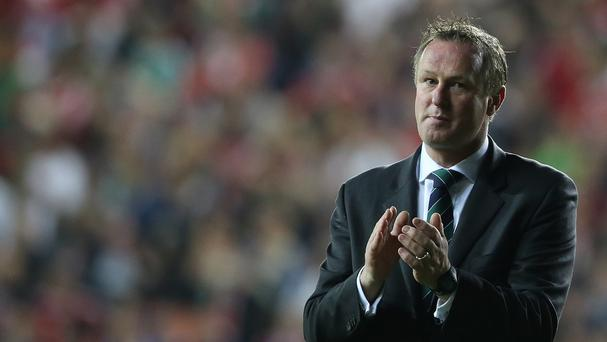 Michael O'Neill will be hoping his sums add up come kick-off in the Greece tie.