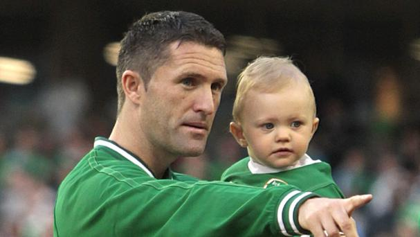 Robbie Keane's son Robert Jr, right, has a new baby brother