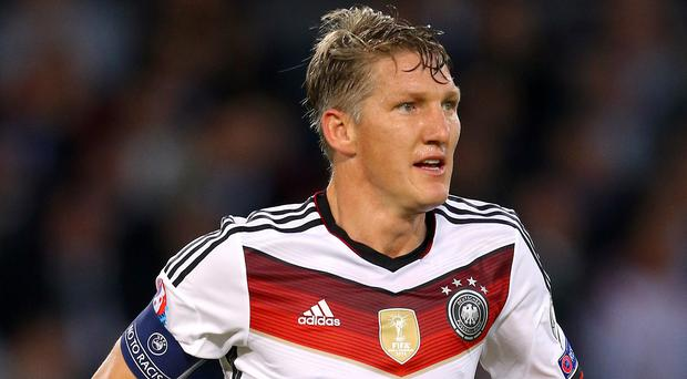 David Meyler is ready to tackle Germany's Bastian Schweinsteiger, pictured