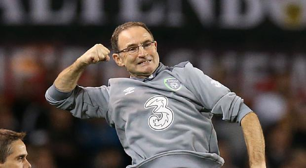Republic of Ireland manager Martin O'Neill celebrates a famous victory over world champions Germany