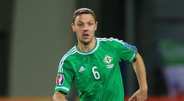 Chris Baird, pictured, has urged team-mate Paddy McNair to consider specialising in one positon