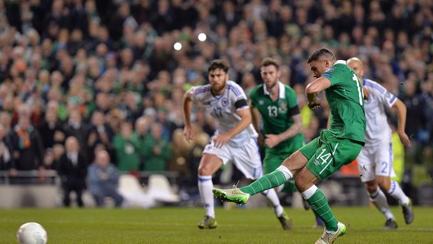 Republic of Ireland's Jonathan Walters scores from the penalty spot in the Euro 2016 play-off