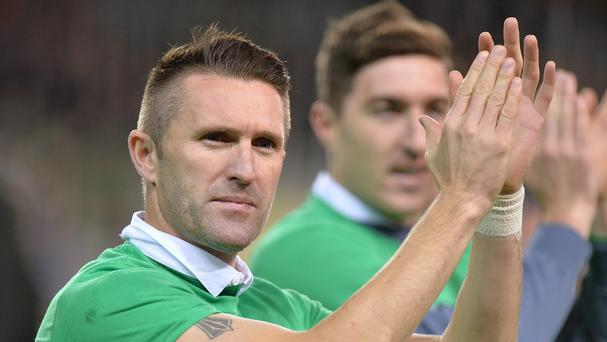 Republic of Ireland skipper Robbie Keane, left, celebrates qualification for the Euro 2016 finals